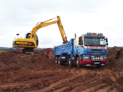 Rentons tipper with yellow JCB